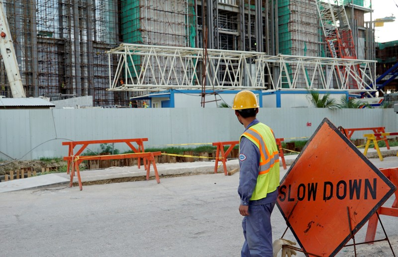 FILE PHOTO: A worker stands outside the construction site of the new Best Sunshine Live casino at Saipan, a U.S. South Pacific island