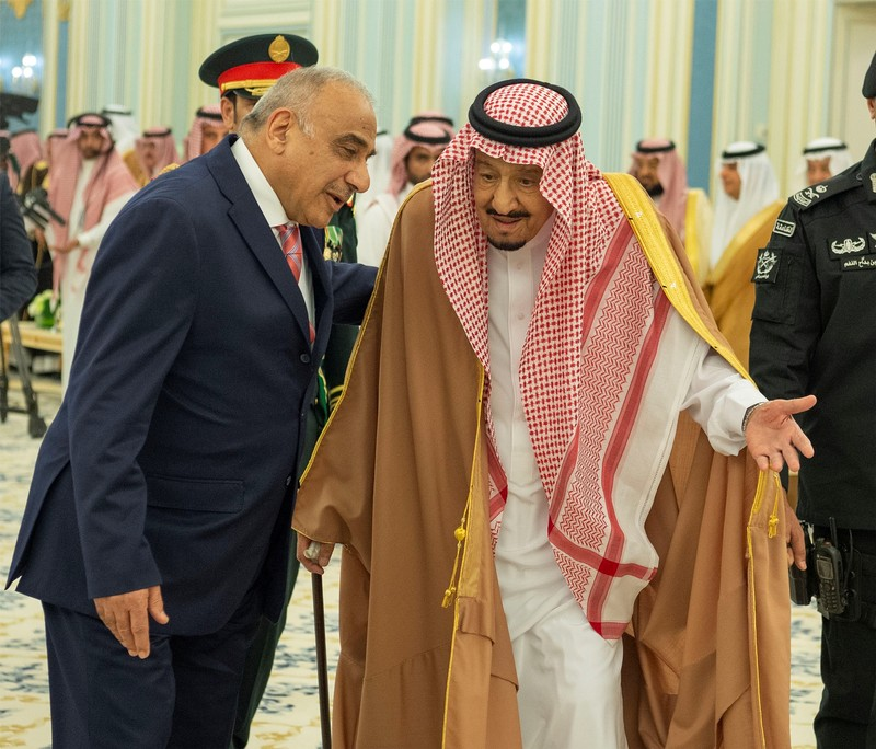 Saudi Arabia's King Salman bin Abdulaziz walks with Iraq's Prime Minister Adel Abdul Mahdi in Riyadh