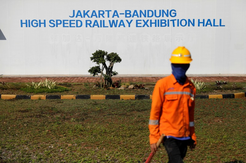 Worker stands in front of Jakarta-Bandung High Speed Railway exhibition hall at Walini tunnel construction site in West Bandung regency