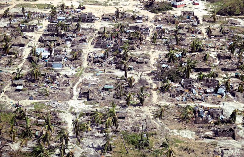 Buildings damaged during Cyclone Kenneth are seen from the air in a village north of Pemba, Mozambique