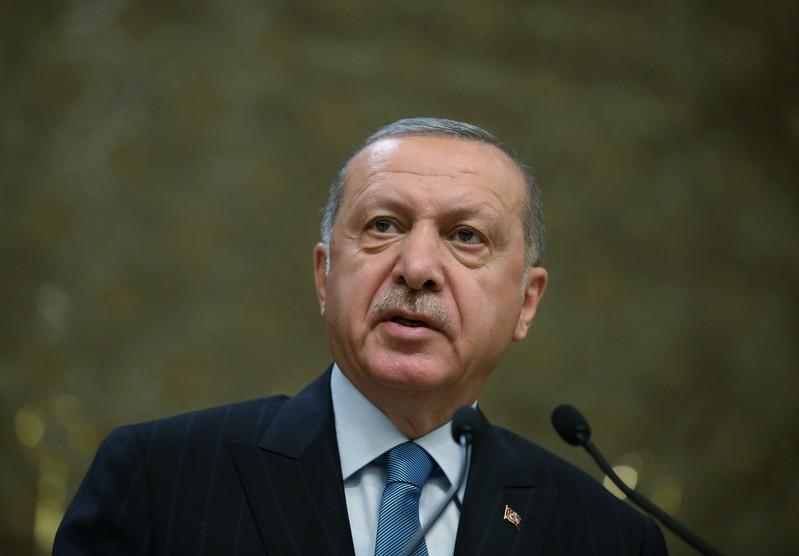 FILE PHOTO - Turkish President Erdogan speaks during a meeting in Ankara