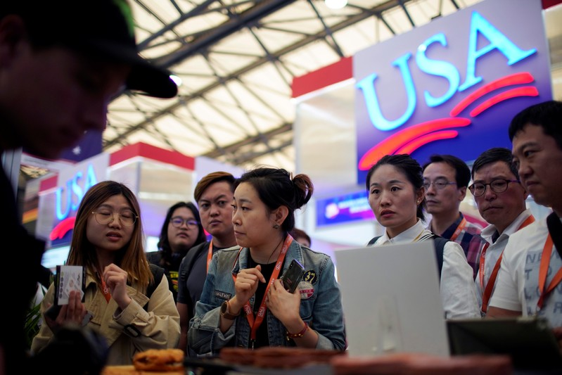 FILE PHOTO: People visit U.S. food booths at SIAL food innovation exhibition, in Shanghai