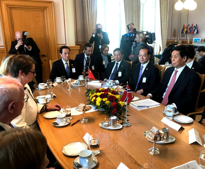 Chairman of China's Standing Committee of the National People's Congress Liu Zhanshu listens to President of the Norwegian Parliament Troen in Oslo