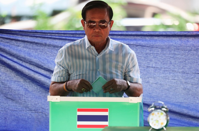 FILE PHOTO: Thailand's Prime Minister Prayuth Chan-ocha casts his ballot to vote in the general election at a polling station in Bangkok