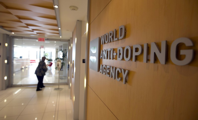 FILE PHOTO - A woman walks into the head offices of WADA in Montreal