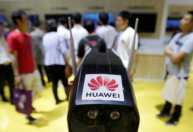 A security robot with Huawei 5G technology is displayed at an exhibition during the World Intelligence Congress in Tianjin