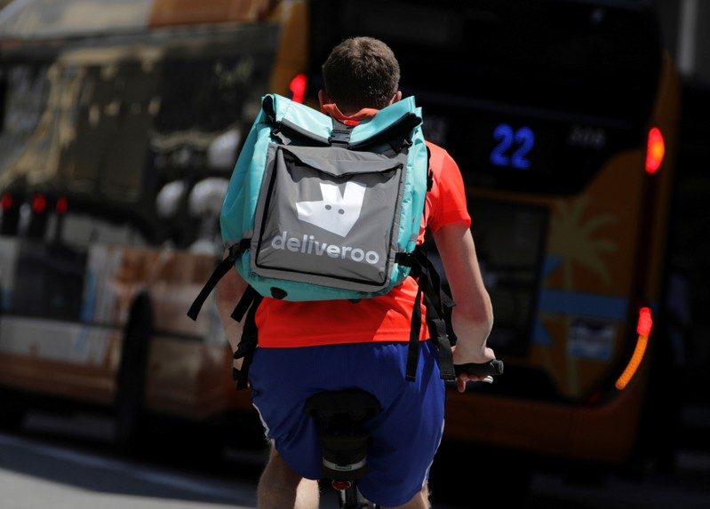 FILE PHOTO: A food delivery cyclist carries a Deliveroo bag in Nice