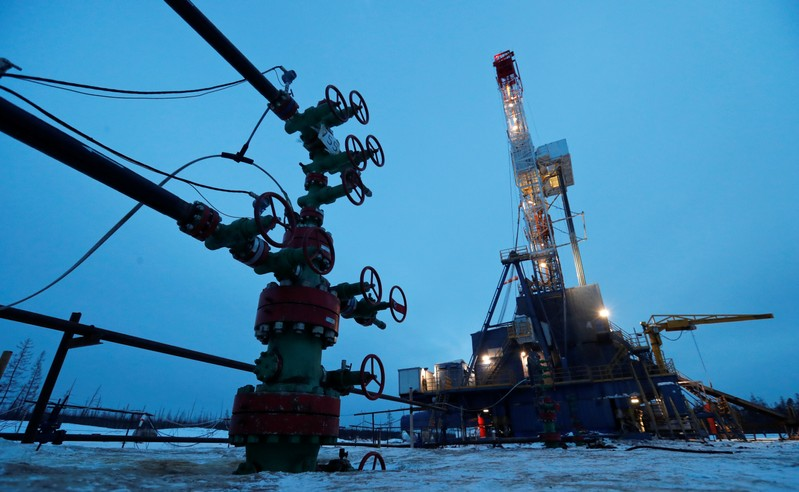 FILE PHOTO: A view shows a well head and a drilling rig in the Irkutsk Oil Company-owned Yarakta Oil Field in Irkutsk Region
