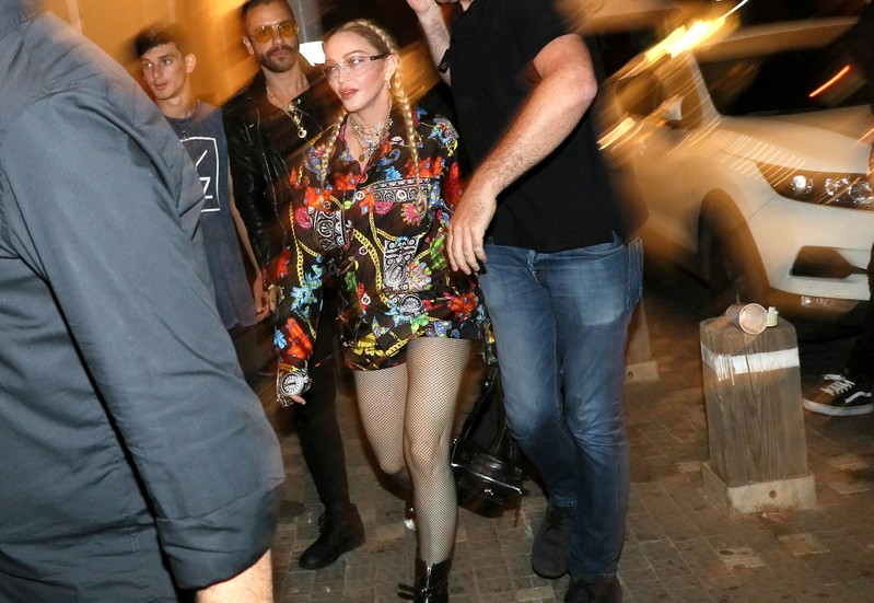 Singer Madonna walks in a street ahead of the final of 2019 Eurovision Song Contest in Tel Aviv