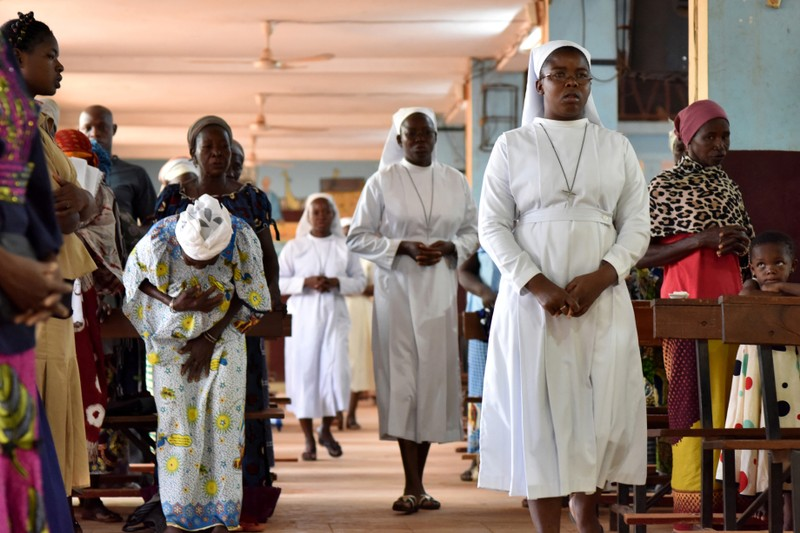 Catholic nuns attend a church service at the cathedral of Our Lady of Kaya in the city of Kaya