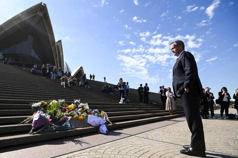 Australian Opposition Leader Bill Shorten is seen in front of the Opera House placing a floral tribute to the late former Australian Prime Minster Bob Hawke in Sydney