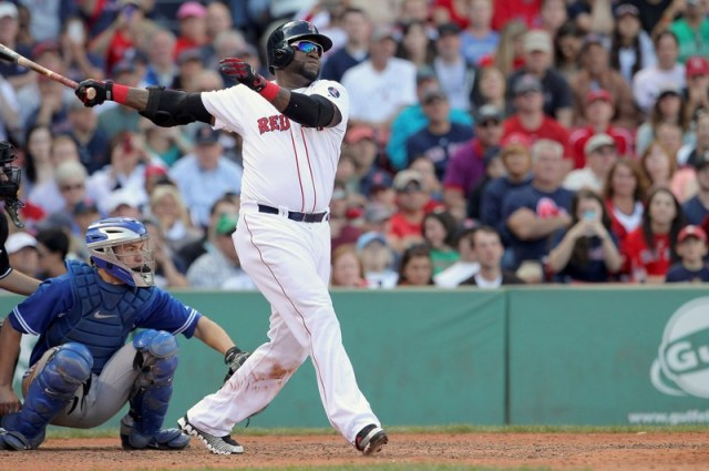 FILE PHOTO: Boston Red Sox designated hitter Ortiz follows through as he flies out in eighth inning against the Toronto Blue Jays during their MLB American League East baseball game in Boston