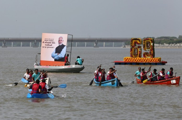 Participants take part in a boat race in the waters of Sabarmati river, to mark Prime Minister Narendra Modi's birthday in Ahmedabad