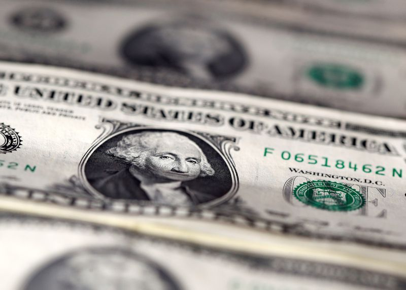 Dollar ticks up after Fed's Powell strikes somber note on economy