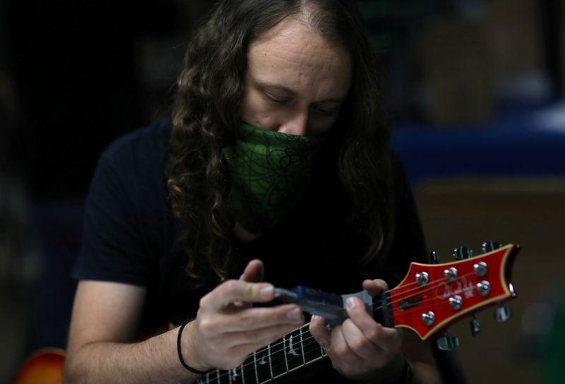 U.S. guitar maker PRS resumes hand-building instruments – at a safe distance