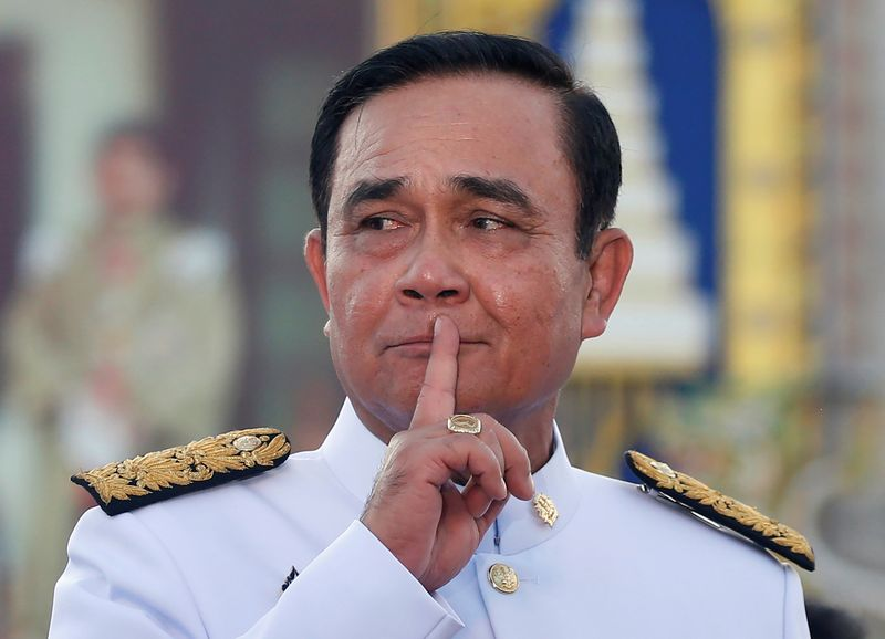 FILE PHOTO: Thailand's Prime Minister Prayuth Chan-ocha reacts while taking questions from journalists after the group photo session with new government cabinet in Bangkok