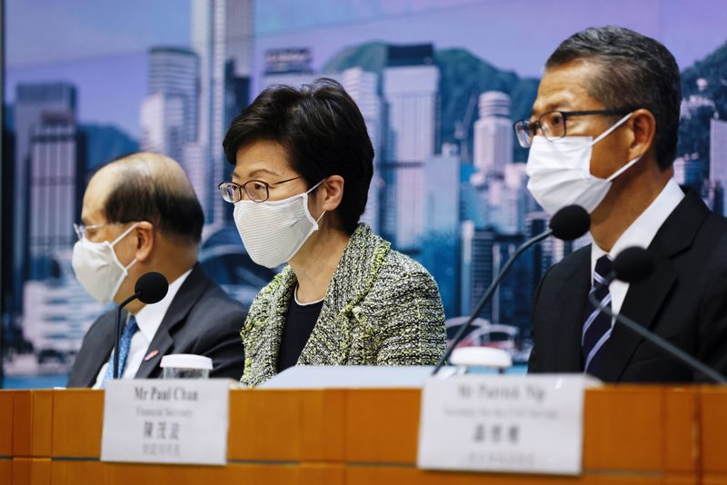 Hong Kong's Chief Secretary for Administration Matthew Cheung, Chief Executive Carrie Lam and Financial Secretary Paul Chan hold a news conference in Hong Kong