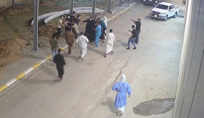 Relatives of a patient, who died from the coronavirus disease (COVID-19), beat up Tarik Sheibani, 47, an Iraqi doctor and director of Al-Amal Hospital, in this still image taken from CCTV footage obtained by Reuters, in Najaf