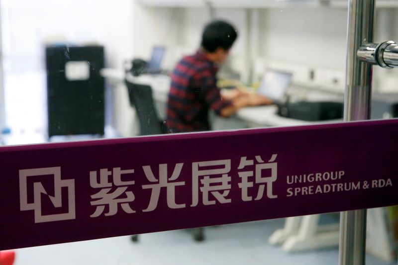 A researcher works at Tsinghua Unigroup research centre in Beijing
