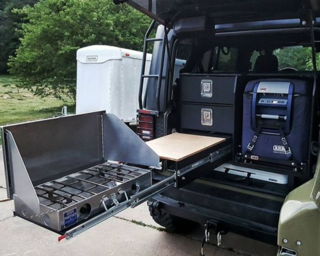 Man's compact camping kitchen system means better off-road cooking