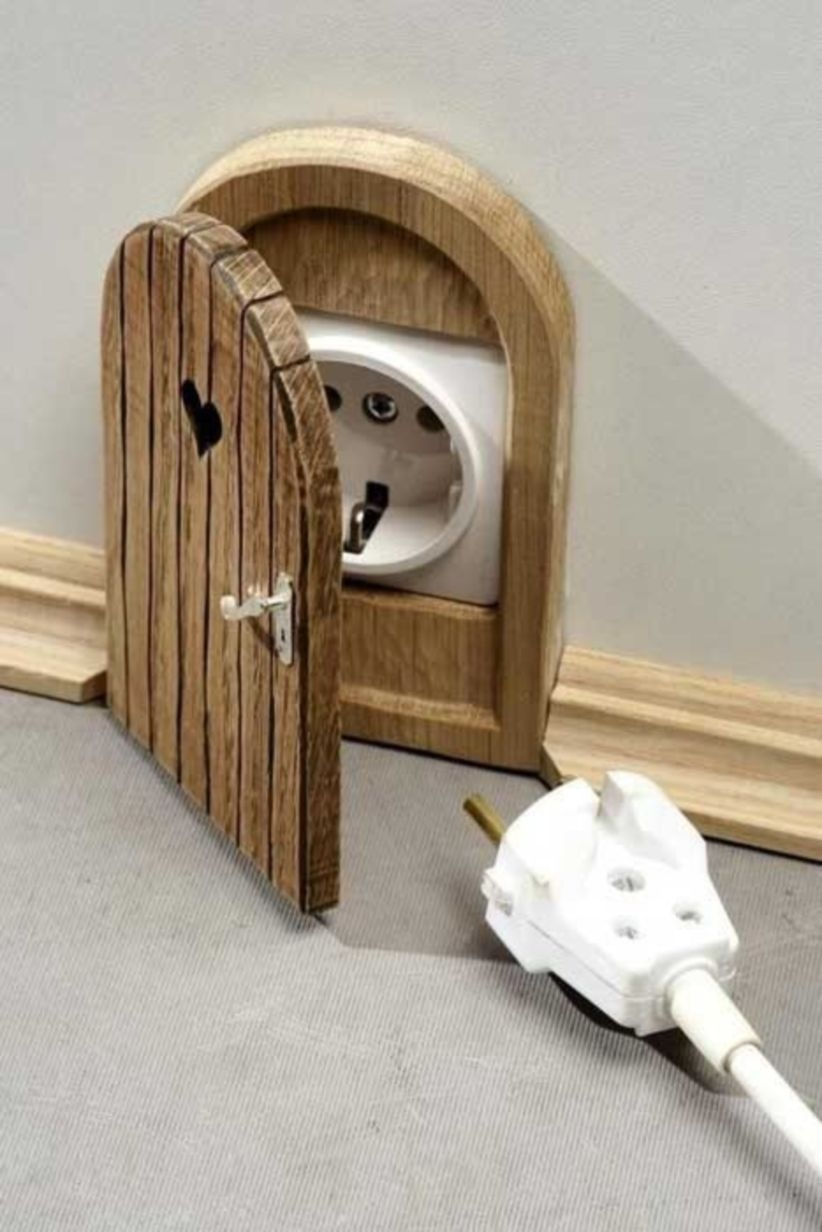Mouse hole door to conceal electrical outlets