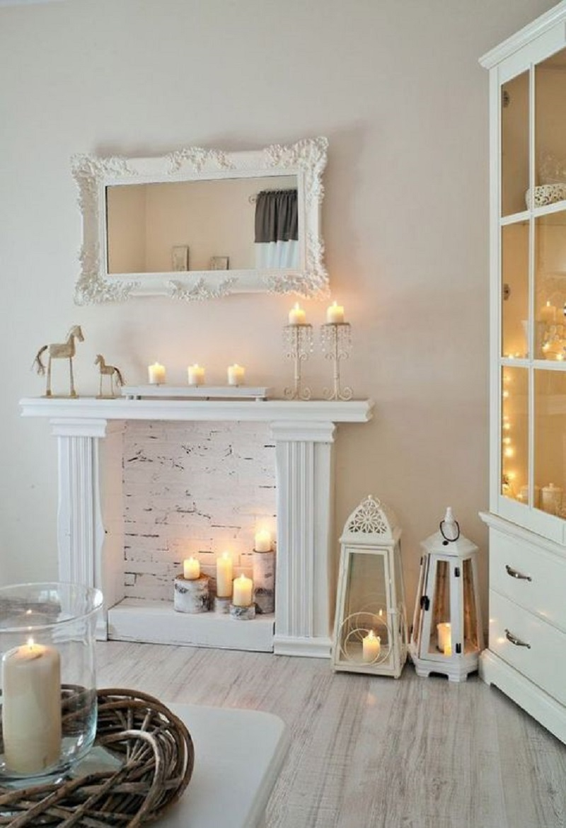 Faux white fireplace with candles