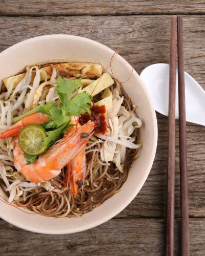 Sarawak Laksa, a spicy and flavourful dish that originates from the Malaysian state of Sarawak.
