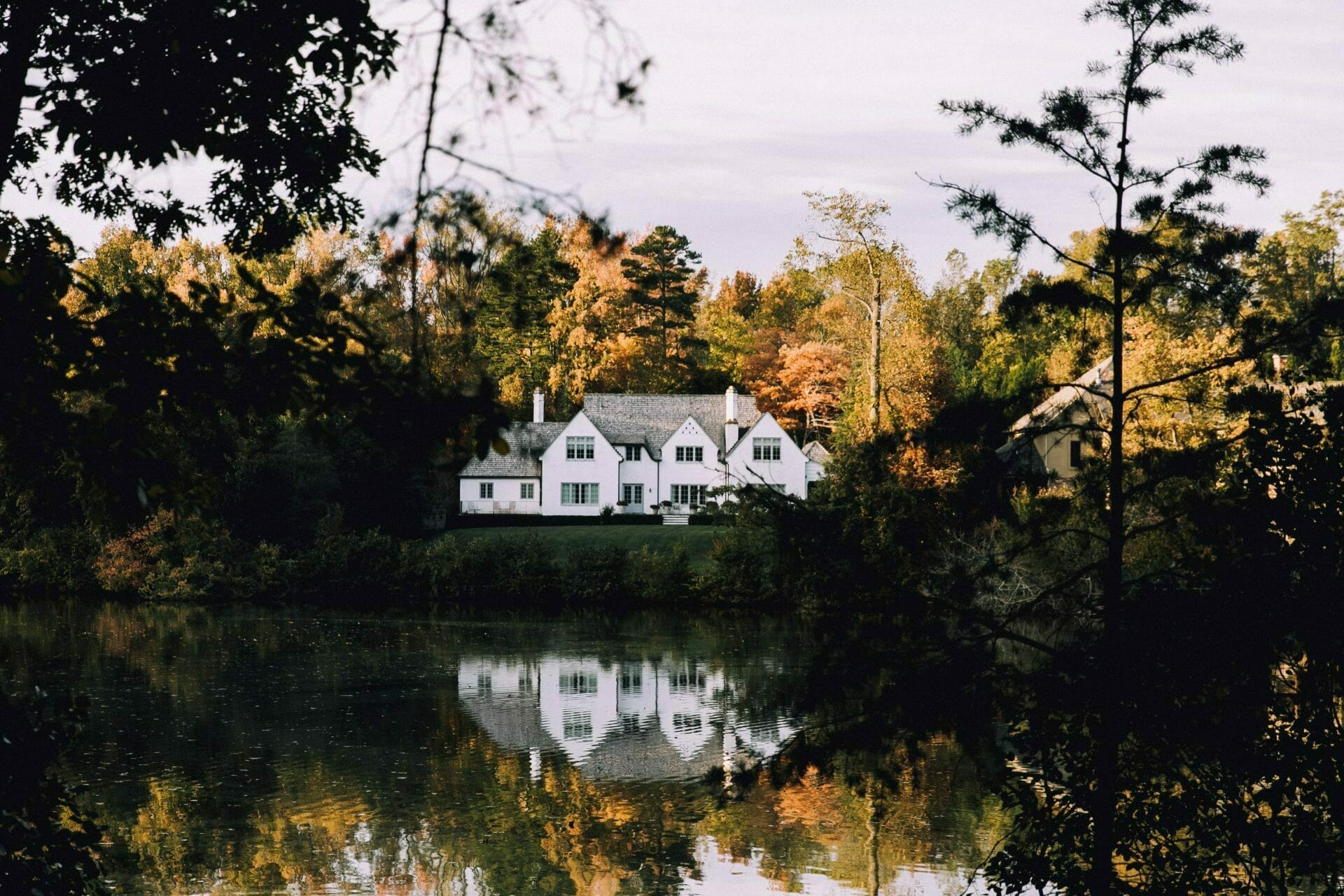 Picture of a White House Next to a Pond for Real Estate News for Investors Podcast Episode #593