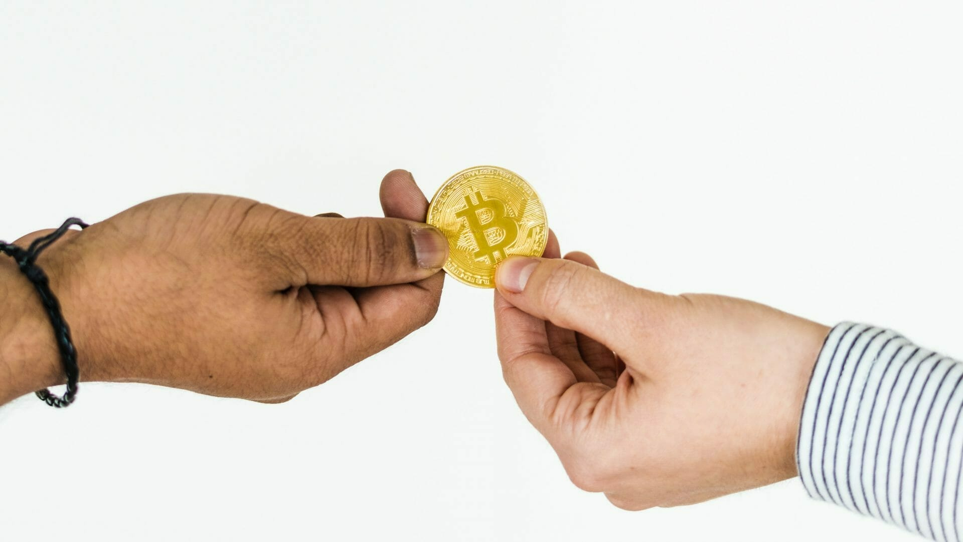Picture of Two People Holding Coin for Real Estate News for Investors Podcast Episode #686