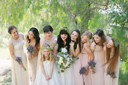 The bridesmaids wore blush dresses picked out by Sam