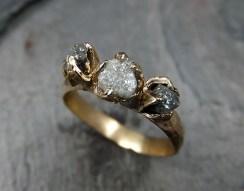Raw three-stone diamond ring, $1,689.05, via Etsy