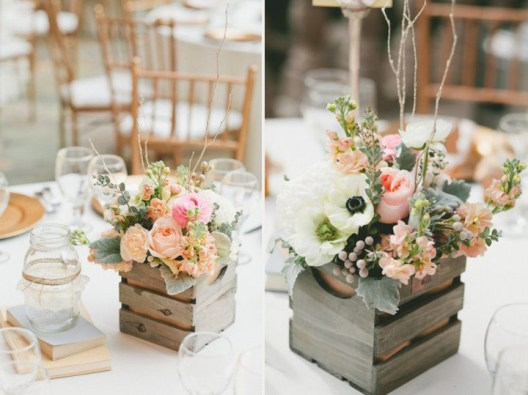 Replace glass vases with recycled materials, including wooden crates. Photo: One Love Photography