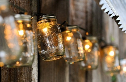 Mason jars strung on fairy lights offer a unique touch to your venue's lighting.