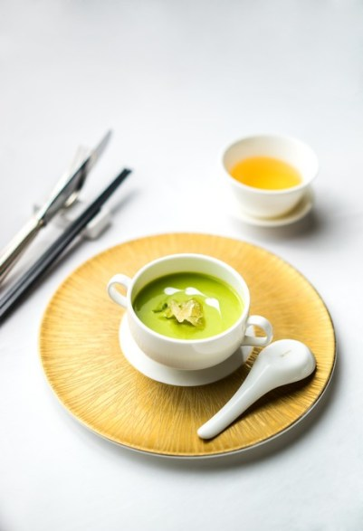 Chilled cream of avocado with coral weed