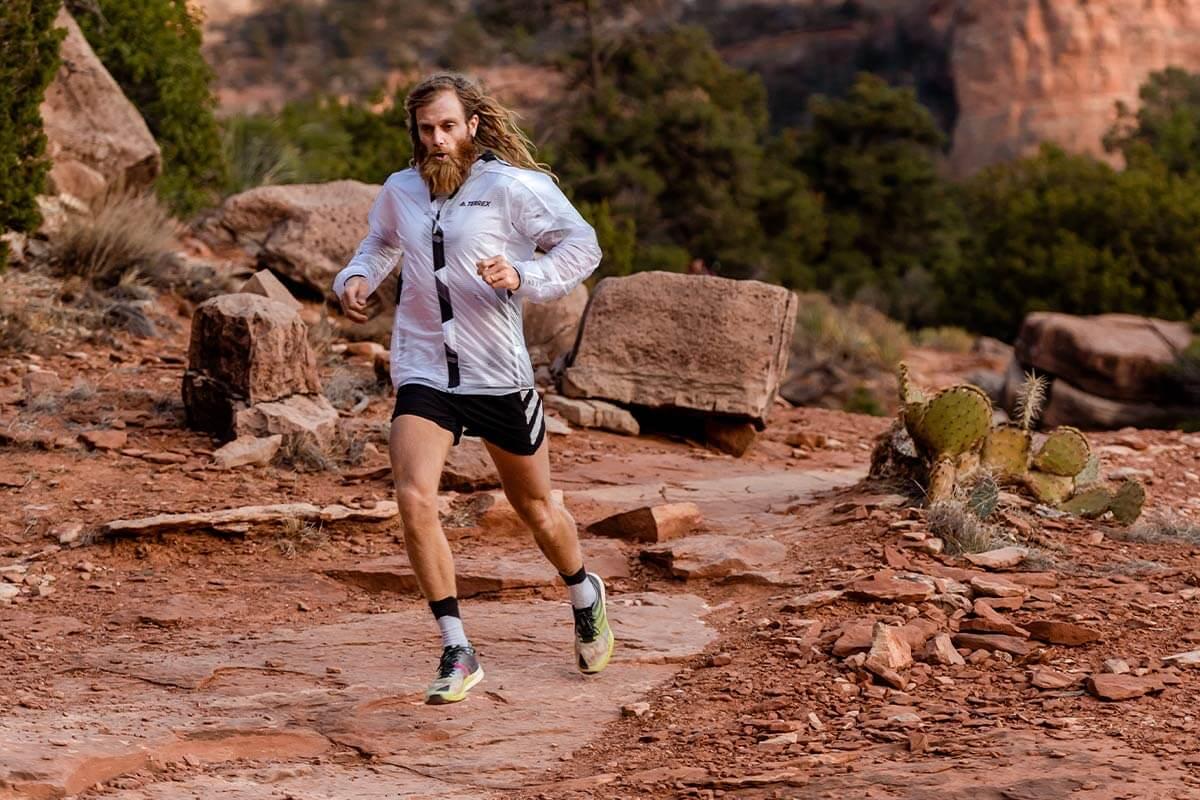 timothy olson running on a trail