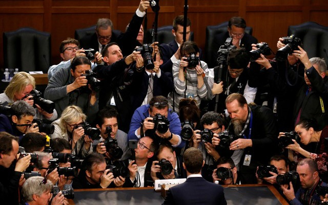 FILE PHOTO: Facebook CEO Mark Zuckerberg is surrounded by members of the media as he arrives to testify before a Senate Judiciary and Commerce Committees joint hearing regarding the company's use and protection of user data, on Capitol Hill in Washington, US, April 10, 2018. Reuters