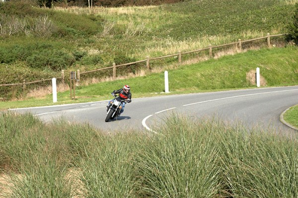 how to drive car or motor bike around a hairpin bend of a - 800×532