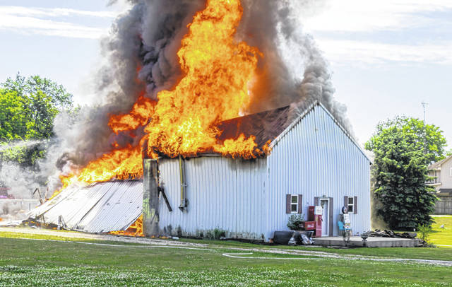 Fire fighters battled a three-alarm blaze at a barn near Greenville Sunday afternoon. No injuries were reported.