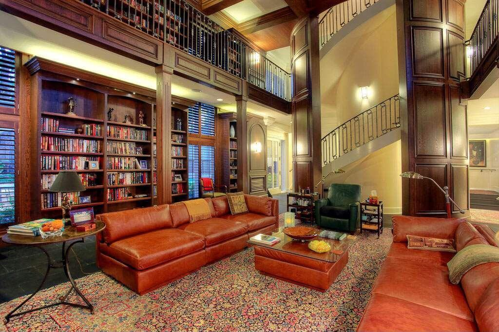 Massive living room and library combination where the library is situated on the main floor and the loft space.  Circular stairs take you to the upper library that overlooks the living room