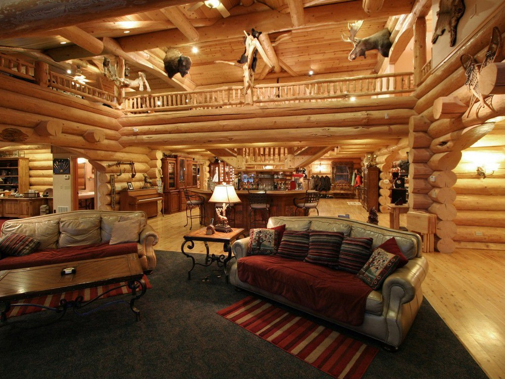 The massive log home above features a large, but unobtrusive loft room