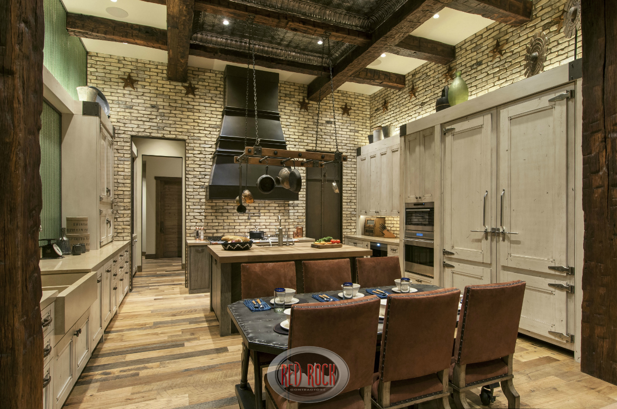 31 Custom  Jaw Dropping  Rustic Interior Design Ideas  Photos  Rustic kitchen design with natural wood flooring  brick walls and custom  cabinetry