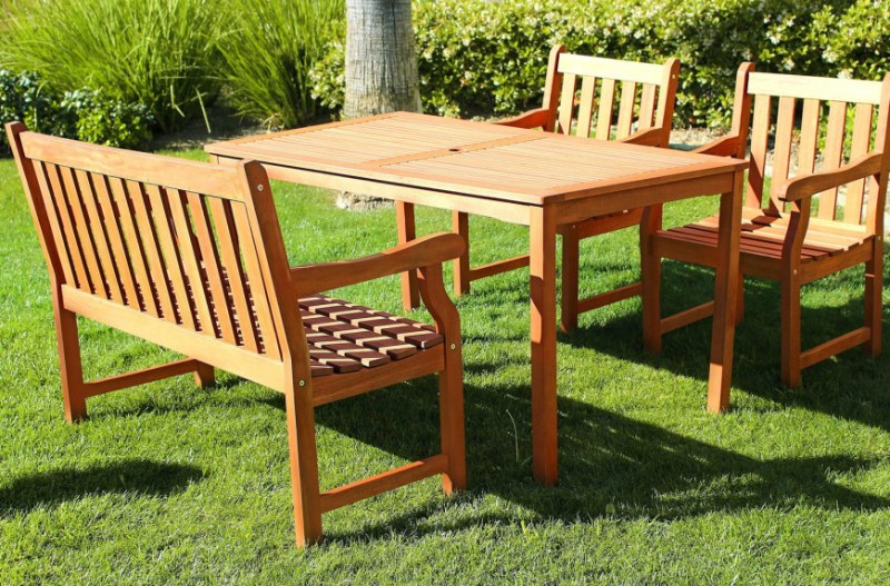 Some tables have a variety of seating options. This table has a bench as well as two matching chairs. It gives people at the table a bit of a choice in their seating arrangements.