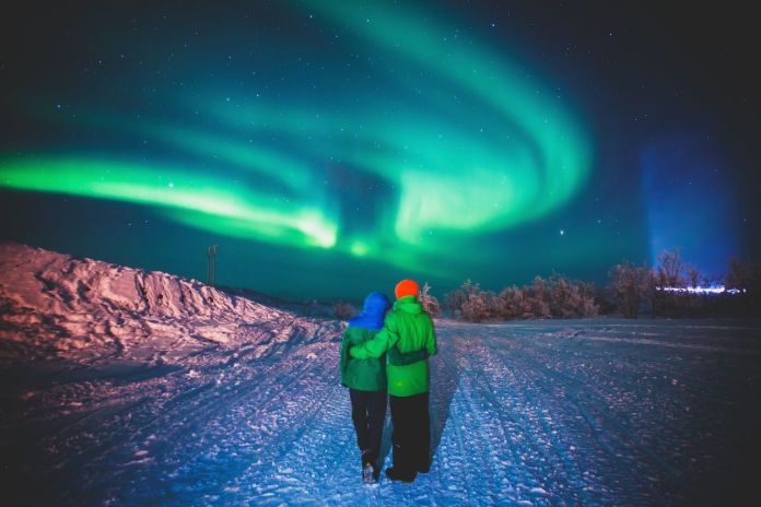 Couple underneath the northern lights