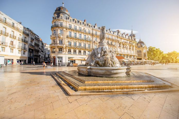 The Comedy square with fountain of Three Graces during the morning light in Montpellier city in southern France