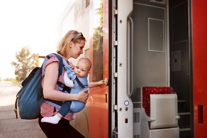 Parent traveling with baby by train