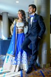 Indian bride and groom in matching blue reception outfits ...