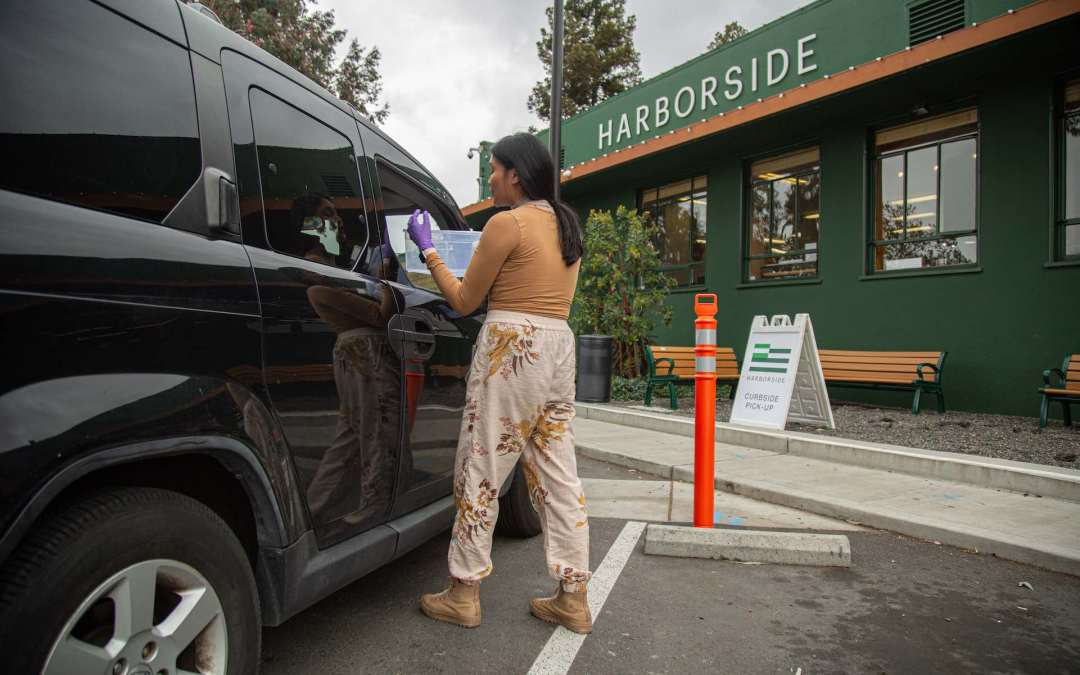 Curbside pickup may well be here to stay. Above, a Harborside employee in Oakland, CA handles a pickup order. (Courtesy Harborside)