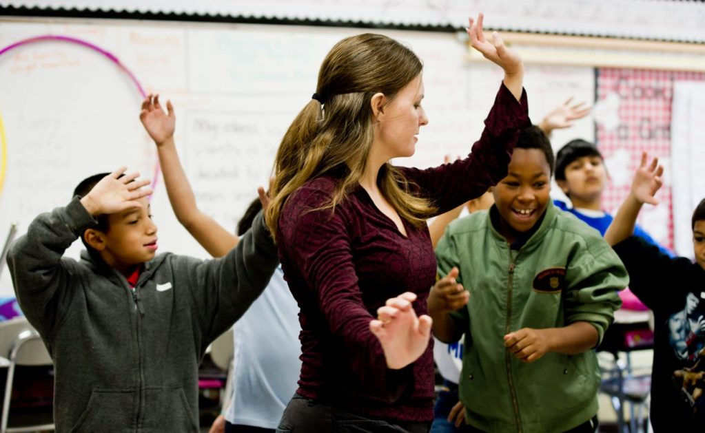 Woman dancing with students
