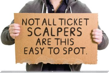 man holding sign that says: Not all ticket scalpers are this easy to spot.