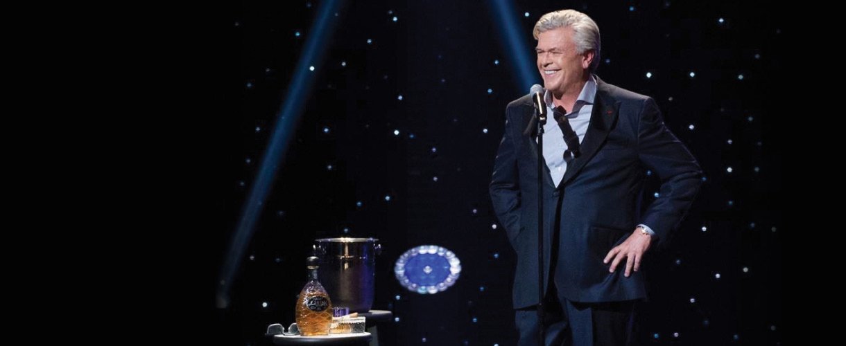 Ron White laughing on stage.